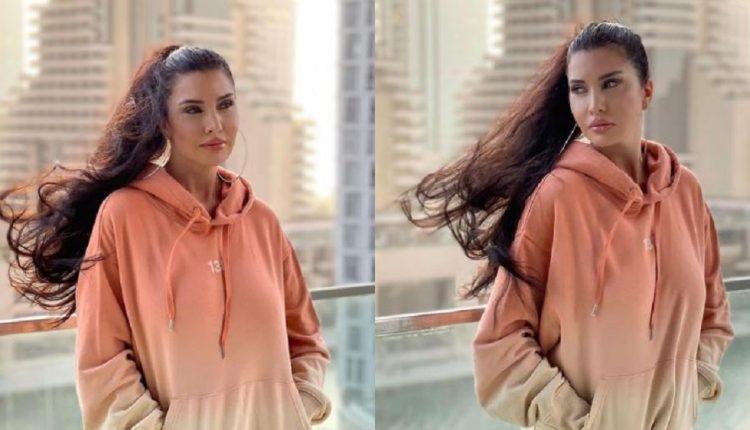 لاميتا فرنجية بملابس رياضية مثيرة في شوارع دبي